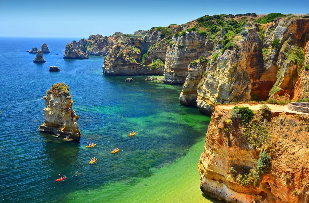 group-of-kayaks-navigate-through-these-crystal-waters-of-praia-dona-ana-lagos-portuguese-algarve-1